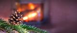 Fototapeta Kawa jest smaczna - Christmas tree with fir tree cone against a stone fireplace.