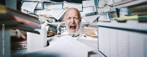 Obraz Screaming businessman drowning under a lot of paperwork - fototapety do salonu