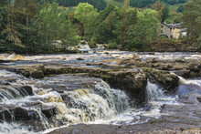The Falls Of Dochart, Spectacular Waterfalls And White Water Rapids On The River Dochart As It Flows Through Dense Woodland In The Village Of Killin, Near Loch Tay In The Scottish Highlands.