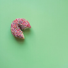 Donut With A Bite On A Green Background