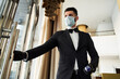canvas print picture Young hotel receptionist working in medical mask and rubber gloves