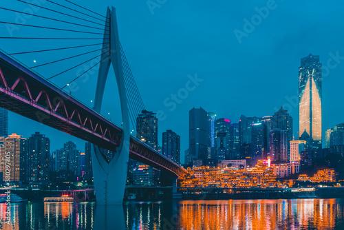 Night view of the Qiansimen bridge and the skyline in Chongqing, China.