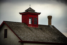 Closeup Of A Brick House And Red Chimney