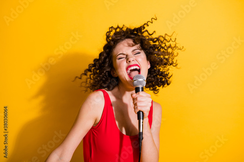 Fotografie, Obraz Closeup portrait photo of cute crazy young girl hand hold mic open mouth eyes cl