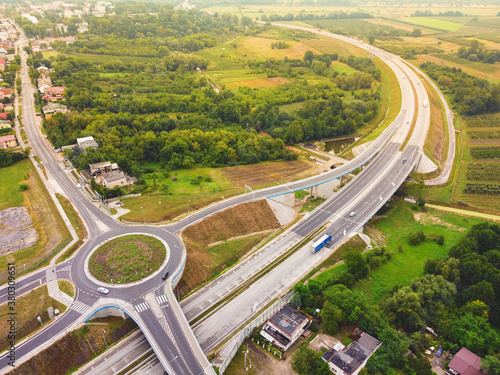 Road junction with roundabouts. Highway. Drone, aerial view. Fotobehang