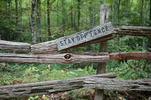 Stay Off Fence Sign On A Broken Split Rail Fence