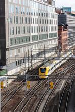 Yellow Train Coming Down The Tracks