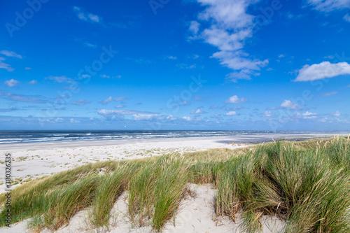 Fototapeta A sunny afternoon at the beach on the East Frisian island Juist, Germany. obraz