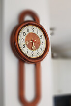 Wooden Clock Hanging By The Wi...