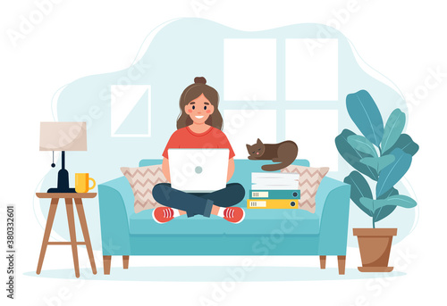 Home office concept, woman working from home sitting on a sofa, student or freelancer.