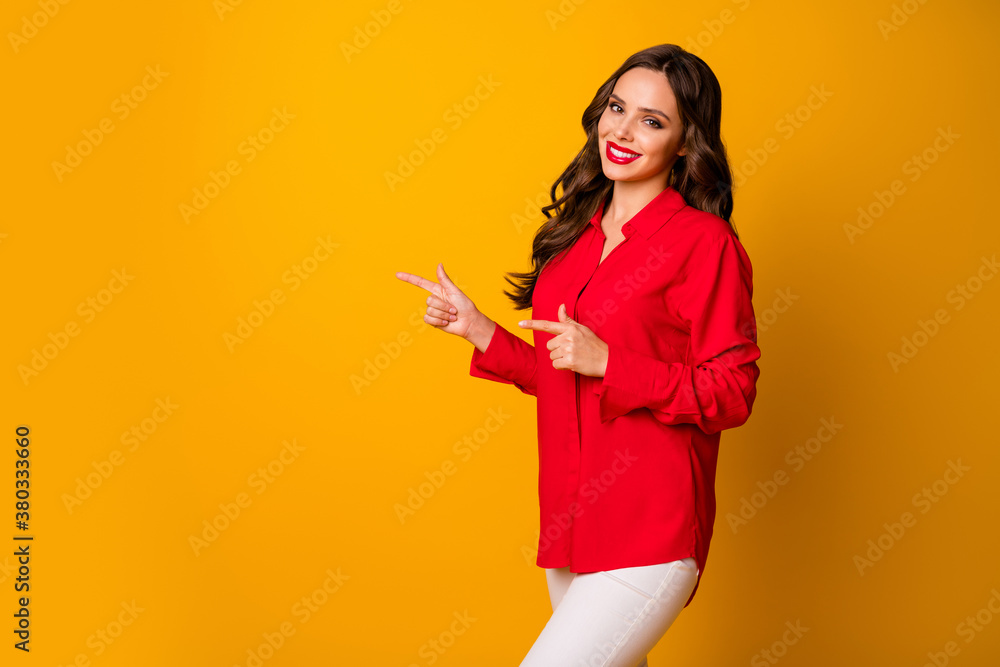 Fototapeta Photo of attractive pretty business lady hold hands directing fingers side empty space sales manager wear red office shirt white pants isolated yellow vibrant color background
