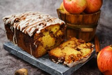 Homemade Apple Fritter Bread Drizzled With White Glaze On Fall Autumn Background, Selective Focus