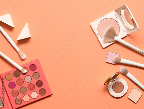 Fototapeta Beauty cosmetic makeup luxury set. Fashion woman make up product, brushes, lipstick, nail polish, coral collection. Creative concept. Cosmetology make-up accessories banner, top view. obraz