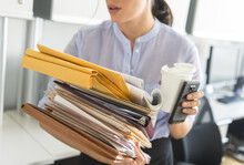 Business Woman Holding Stack O...