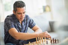 Mature Man Playing Chess