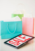 Digital Tablet And Shopping Bags