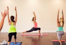 Women Exercising Yoga