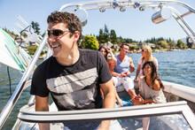 Young People Enjoying Speedboat Ride