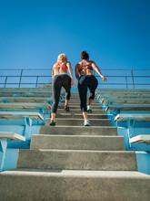 Two Women Walking Up Steps