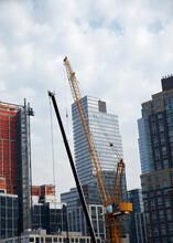 Cranes In Urban Scene