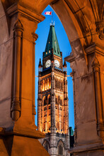 Illuminated Peace Tower Seen Through Lancet Arch
