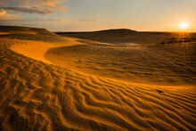 Sunrise Over Sand Dunes
