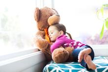 Girl (4-5) Embracing Teddy Bear