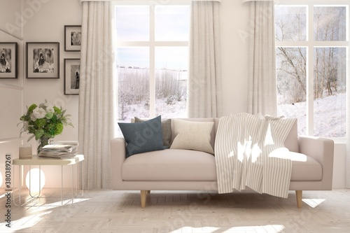 Obraz na plátně White living room with sofa and winter landscape in window