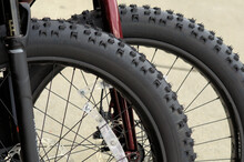 Rear Wheels, Nubby Tires Of Two Off-road Bikes..