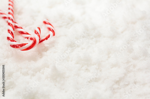 Candy canes on snow with copy space Fototapet