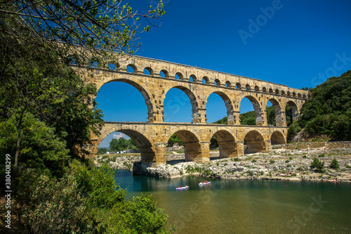 Fotografering Avignon, France - 6/4/2015:  Pont du Gard, a Mighty aqueduct bridge rising over 3 well-preserved arched tiers, built by 1st-century Romans
