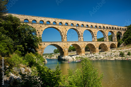 Leinwand Poster Avignon, France - 6/4/2015:  Pont du Gard, a Mighty aqueduct bridge rising over 3 well-preserved arched tiers, built by 1st-century Romans