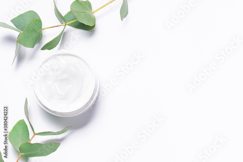 Natural organic moisturizing cream with eucalyptus extract on white background with copy space for your design. Skin care concept.