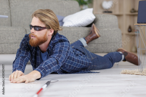 Fototapeta blind man fallen on the floor in his home obraz
