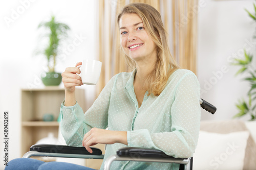 Fototapeta young office worker in wheelchair having tea obraz
