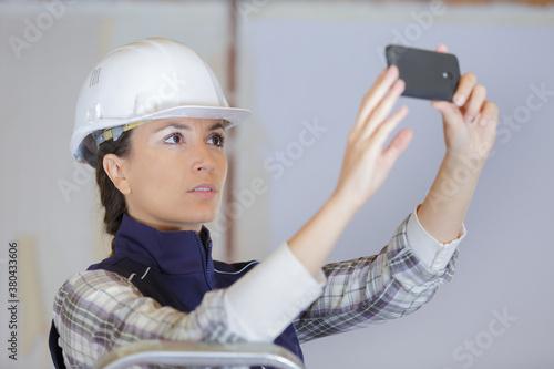 Fototapeta builder talking a picture in construction site obraz