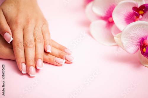 The picture of female hands with perfectly done manicure.