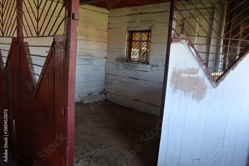 stable interior with metal doors and cage Wallpaper Mural