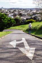 Woman Walking On A Sloping Road