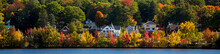 Homes Along The Shore Of Paugus Bay On Lake Winnipesaukee, Near Laconia, New Hgampshire.
