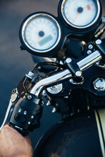 Young Man's Hand On Motorcycle