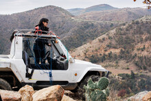 Woman With Offroad 4wd Car In The Mountains