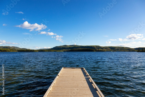 Wooden Quay at Twin Lakes Campground during a sunny summer day Wallpaper Mural