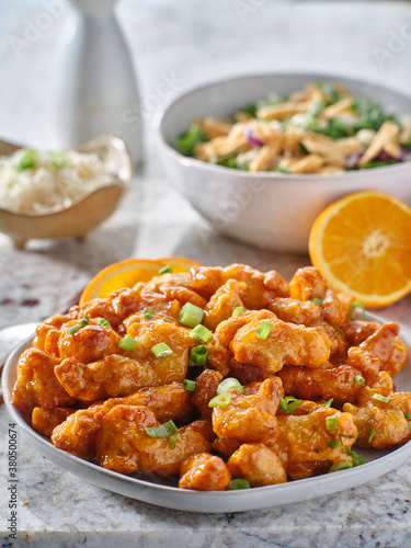 Fotografie, Obraz plate of chinese orange chicken with green onion garnish