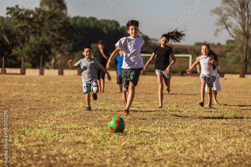 Children on soccer field running and playing