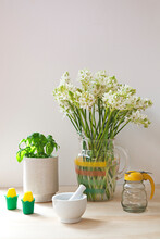 Tableau Or Kitchen Vignette With Flowers And Basil And Utensils