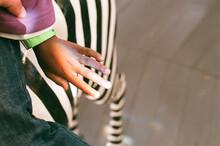 Rainbow On A Black Girl's Hand Sitting On A Carousel Zebra