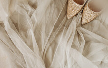 Shining Gold Shoes On Soft Sof...