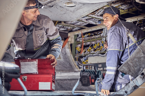 Caucasian men mechanics and technicians are repairing aircraft in the indoors Canvas Print