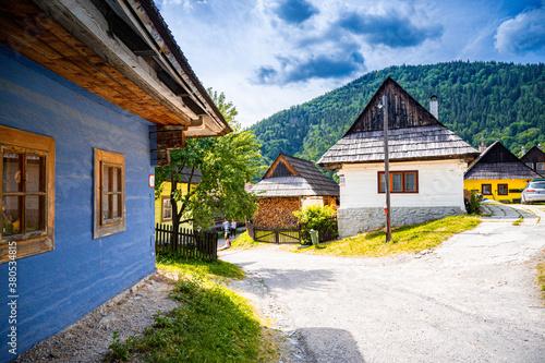 Fototapeta Colorful old wooden houses in Vlkolinec. Unesco heritage. Mountain village with a folk architecture. Vlkolinec, ruzomberok, liptov, slovakia. obraz